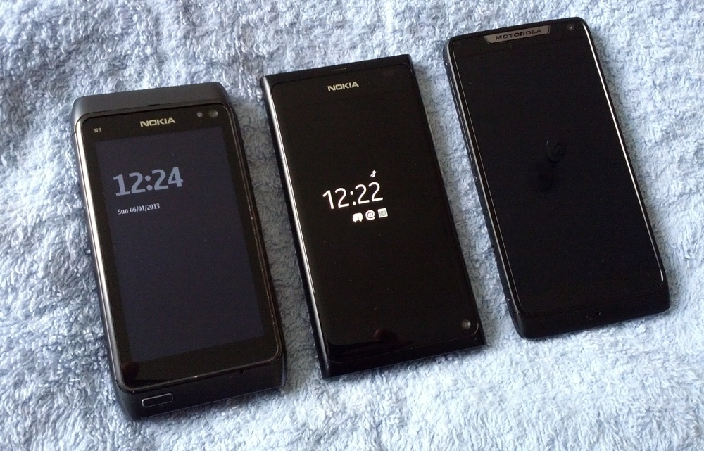 Three hand-sized smartphones