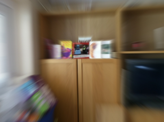 Room context (zoom blurred)