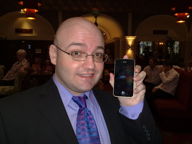 David testing the best man's iPhone 4