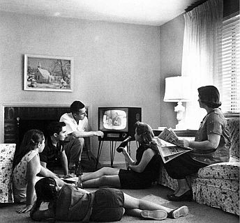 Family watching an old television