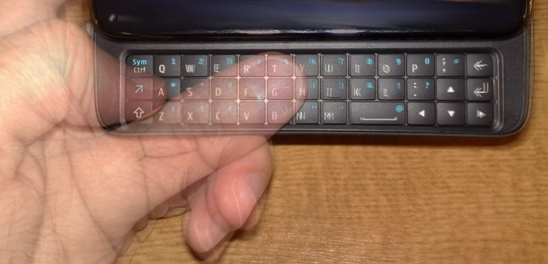 Thumb stretching to cover its half of the N900 keyboard