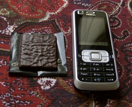 After Eight mint next to Nokia 6120 Classic